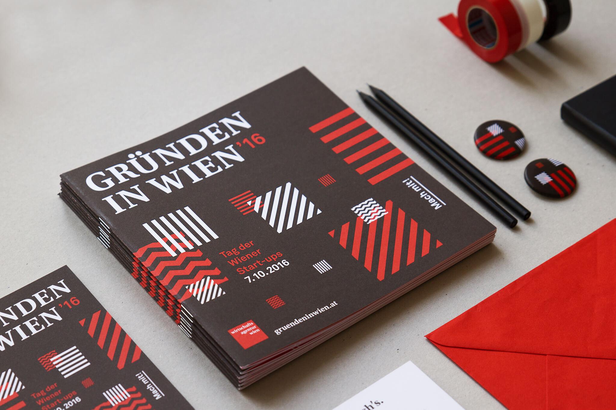 Gründen in Wien Folder, Pins und Kuverts in schwarz-rot-weißem Corporate Design